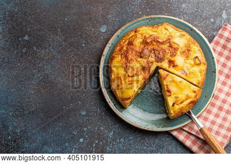 Homemade Spanish Tortilla With One Slice Cut - Omelette With Potatoes On Plate On Stone Rustic Backg