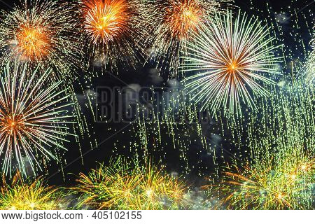 Vivid Fireworks With Vivid Colorful Sparks And Firecrackers. Explosive Pyrotechnic Dazzling Display.