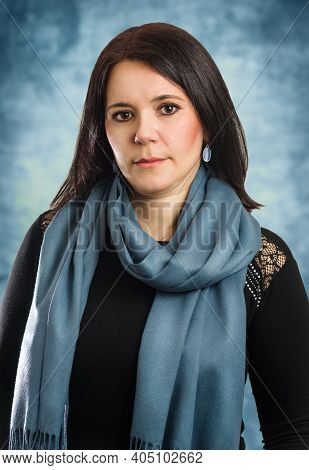 Serious Middle Age Caucasian Business Woman Wearing Black Blouse And Blue Scarf Relaxed With Serious