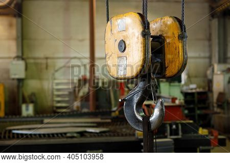 Large Hook On A Crane For Lifting Heavy Objects In Metallurgical Production. Indoor Hook On Cables