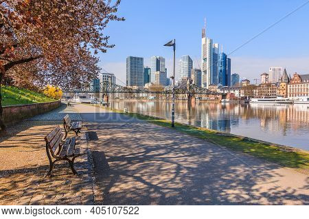Skyscrapers In The Financial District With Reflections. Park And Path On The Banks Of The Main On Th