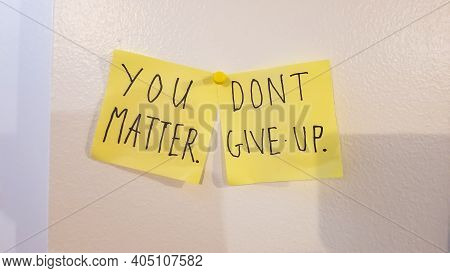 You Matter, Dont Give Up Encouragement Phrase Written On Two Yellow Sticky Notes Posted On A White S