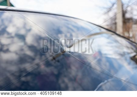 Broken Windshield With Big Crack Through The Glass, Damaged Car