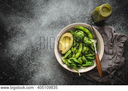 Green Healthy Salad With Spinach, Brussels Sprouts, Avocado In Bowl, Green Detox Smoothie In A Bottl