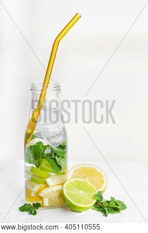 Lemonade On White Background. Drink With Fresh Lemons. Lemon Cocktail With Juice And Ice. Water With