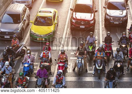 Bangkok, Thailand - December19,2020: High Angle View Of Many Motorcyclists And Cars Stuck On Junctio