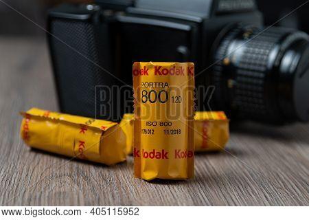 Latvia, Riga, January 26, 2021: Different Kodak Rolls Of 120 Film On A Wooden Table Film Photography