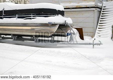 A Storage Yard With Catamaran Or Boat On A Trailer, Winter Scene
