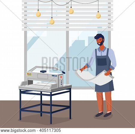 Employee Of A Printing House At Work Prepares Paper For A Printing Machine Or Plotter. Male Worker I