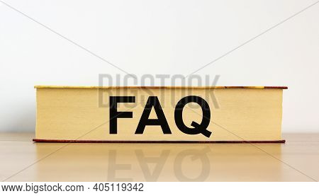 Faq, Frequently Asked Questions Symbol. Book With Word 'faq, Frequently Asked Questions' On Beautifu