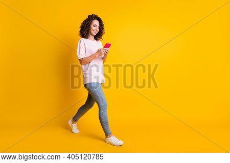 Full Length Body Size Photo Of Female Millennial Using App Mobile Phone Walking Isolated On Vibrant