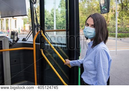 Almaty, Qazaqstan - September, 09, 2020: Young Woman Wearing A Protective Medical Face Mask Getting
