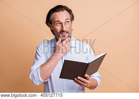 Portrait Of Nice Creative Cheerful Smart Man Wearing Specs Reading Book Thinking Isolated Over Beige