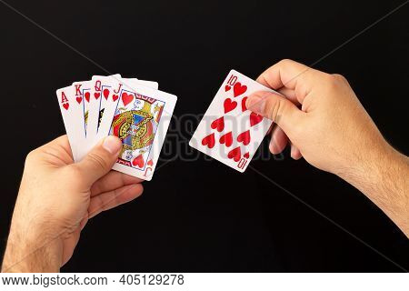 Male Hands Holding Combination Of Royal Flush Poker Cards On Dark Background. Casino, Luck And Fortu
