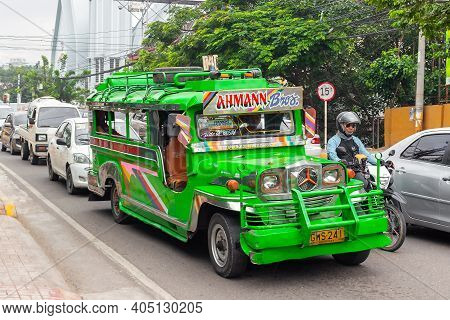 Cebu, Philippines - October 3, 2018: Colourful Jeepney Taxi In Traffic Jam On City Street. Cheap Pub
