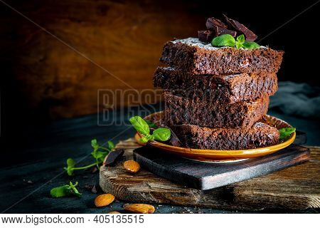 Pieces Of Homemade Chocolate Brownie Garnished With Mint Leaves
