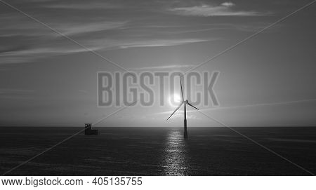 Sunrise From The Sea With Marine Platform And Windmill, Monochrome Mode