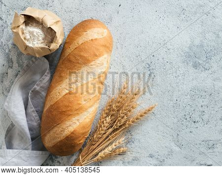 British White Bloomer Or European Baton Loaf Bread On White Marble Background. Top View Or Flat Lay.
