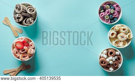 Rolled Ice Creams In Cone Cups On Blue Background. Different Iced Rolls Top View Or Flat Lay. Thai S