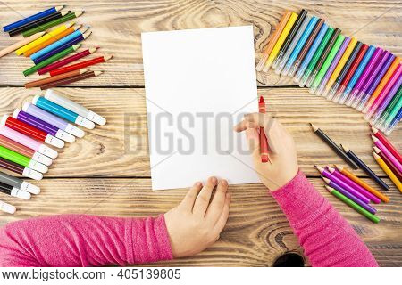 Little Girl Prepares To Paint On A Blank Sheet Of Paper. Drawing Is Done By A Child With Colored Pen