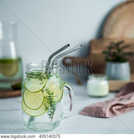 Cold Drink In Mason Jar With Metal Straws On Kitchen Table. Lemonade Or Detox Water With Lime And Th