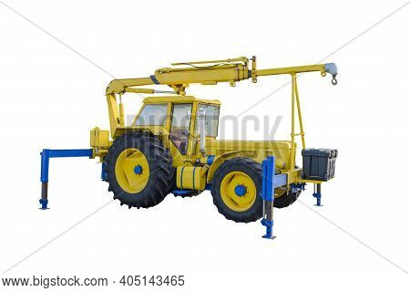 Yellow Tractor With Telescopic Boom On Supports Isolated On White Background
