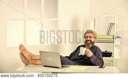 Business Coach. Man Is Working At Home During Coronavirus Pandemic. Man Sit On Comfortable Chair Usi
