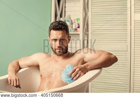 Men Bodycare. Macho Naked In Bathtub. Sex And Relaxation Concept. Man Wash Muscular Body With Foam S
