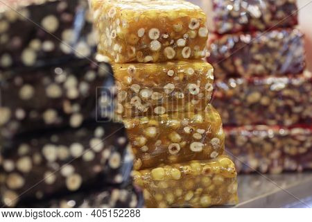 Multi-colored Brittle Are On Counter Of Store. Sweets From Seeds And Nuts Concept