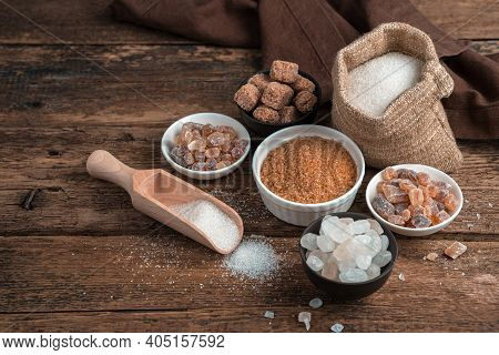 Sugar Of Different Types On A Wooden Background. Side View With Copy Space.