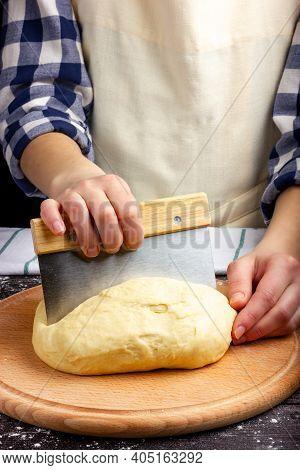 Woman Baker Prepares Dough. Bread Dough. Kneading The Dough. Female Hands Stir The Dough. Rustic Sty