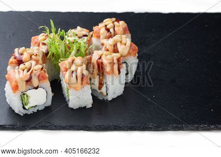 Traditional Delicious Fresh Sushi Roll On A Black Background With Reflection. Sushi Roll With Rice,