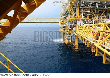 Offshore Construction Platform For Production Oil And Gas. Oil And Gas Industry And Hard Work. Produ