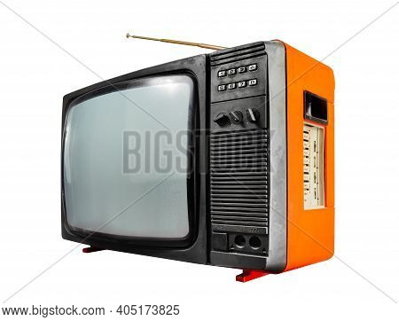 Isolated Photo Of An Old Black And Orange Colored Soviet Tv Set Side View On White Background.