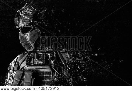 Black And White Photo Of A Fully Equipped Soldier Face And Torso Standing In Tactical Clothing And D