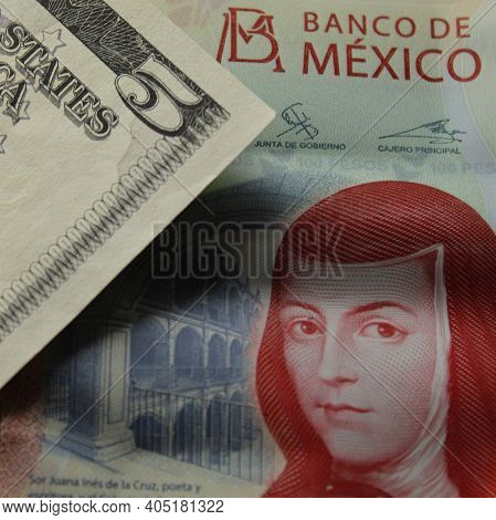 Approach To Mexican Banknote Of 100 Pesos And American Five Dollars Bill