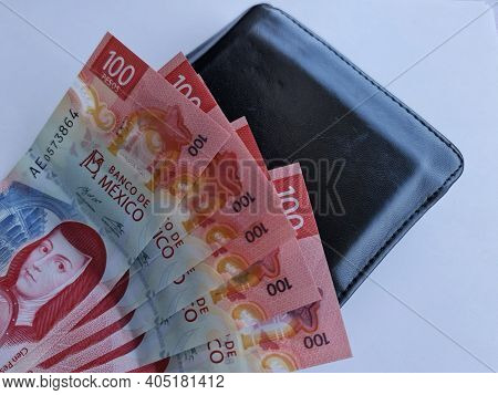 Mexican Banknotes Of 100 Pesos And Black Leather Wallet