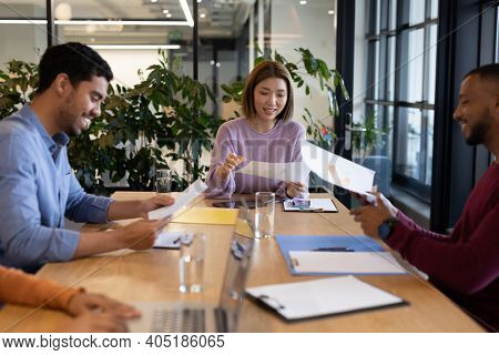 Diverse group of business people working in creative office. group of people in a meeting discussing work. business people and work colleagues at a busy creative office.