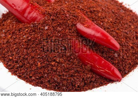 Korean Chili Pepper Powder With Chili Peppers, On A White Background.