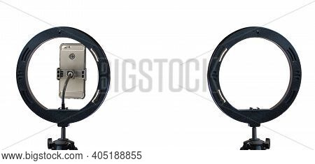 Ring Lamp And A Smartphone On A Tripod Isolated On A White Background With A Clipping Path.  Inexpen