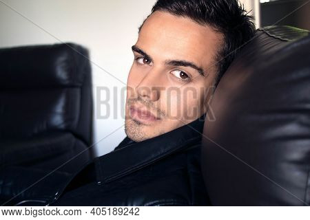 Semi Naked Handsome Man Sitting In Leather Armchair With Open Shirt Revealing Sixpack Abs And Open J