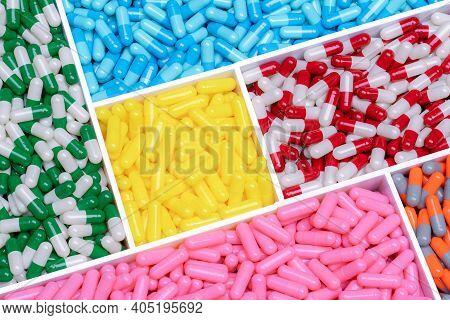 Above View Capsule Pills In Plastic Box. Multi Colored Capsule Pills. Vitamin And Supplement Concept
