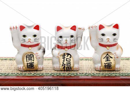 Japanese Lucky Cat On White Background, Japanese Word Of This Photography Means