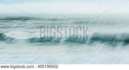 Intentional camera movement of ocean wave, abstract blurred sea background