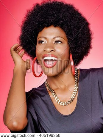 Portrait of young fashionista african american woman wearing red earrings