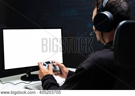 Man playing a game with blank screen computer holding a gaming controller