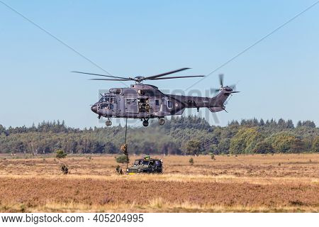 Ede, Netherlands, September 21, 2019: Cougar Helicopter Command S-454 Of The Dutch Army Dropping Sol