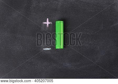 Li Ion Battery On A Blackboard With Plus Minus Pole.