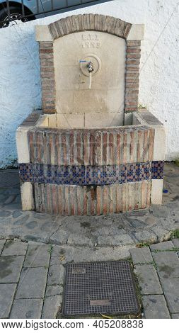 Drinking Water Fountain With Decorative Tile Frontage For Use By Locals In Andalusian Village