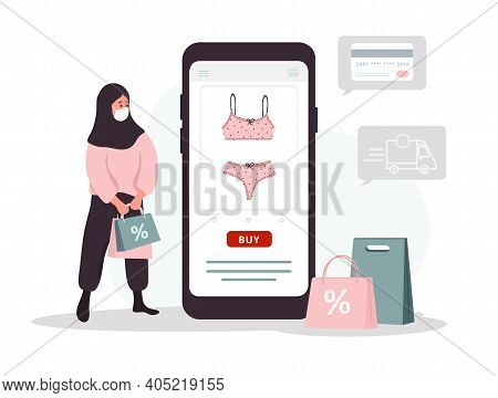 Online Shopping On Website Or Mobile App. Islamic Woman Buys Modern Underwear At Online Lingerie Sto